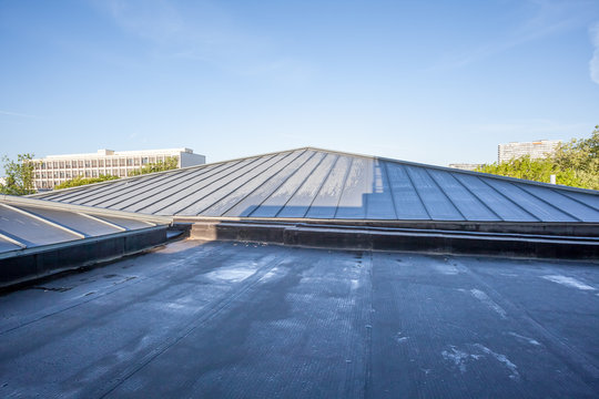 an flat roof on a high building