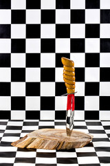 Large sharp knife close-up on a checkered background