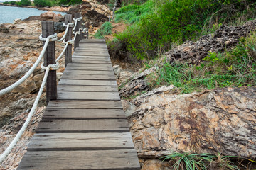 landscape beach bridge near sea with beautiful nature rocks and grass