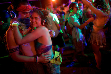A couple embraces while dancing in a silent disco on the fourth and final day of the Firefly Music Festival in Dover, Delaware U.S.