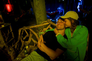 Tyler Cury, 18, and Morgan Coley, 18, embrace on the fourth and final day of the Firefly Music Festival in Dover, Delaware U.S.