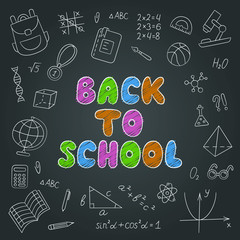 Back to school. Lettering. Chalkboard. Set of school elements in doodle and cartoon style. Vector. EPS 10