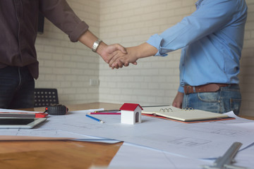 Engineer and Architect concept, Engineer Architects and real estate agent office team shaking hands in office
