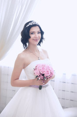 portrait of a mouthful. happy bride with the traditional bouquet. events and people