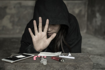 Girl shows palms against drug abuse, The concept of crime and drug addiction. 26 June, International Day Against Drug Abuse and Illicit Trafficking