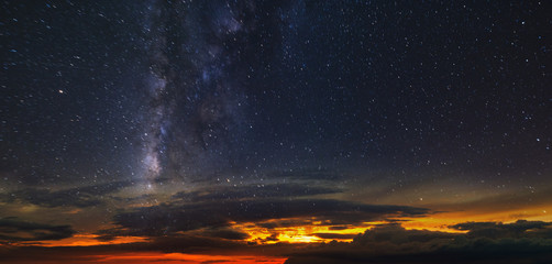 Panorama of the starry sky over the red horizon