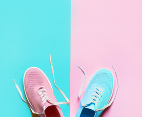 Pink and blue shoes on pink and blue background