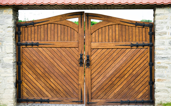 Part of a wooden gate with a metal ring handle