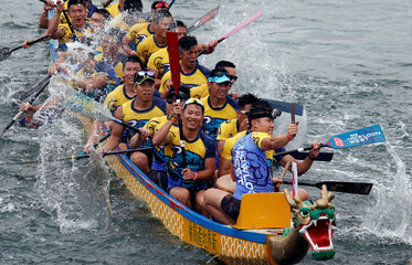 Participants celebrate after winning a race to mark Tung Ng or Dragon Boat Festival in Hong Kong