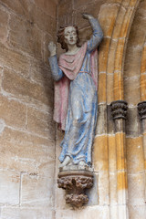 madonna figure on ancient church wall