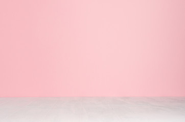 Soft pink pastel wall and white wood desk as blank background.