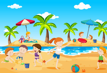 Children Playing at Beach in Summer