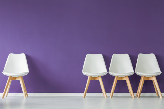 Chairs on purple wall