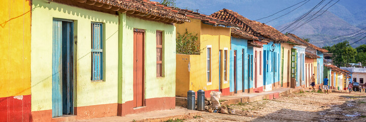 Foto auf Leinwand Karibik Panorama of colorful houses in a paved street of Trinidad, Cuba