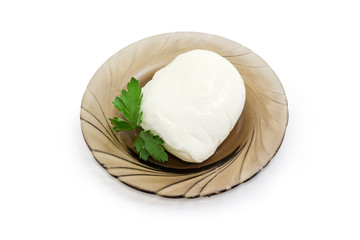 Mozzarella cheese with parsley on dark glass saucer