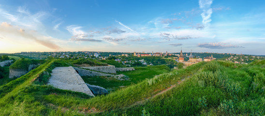 Kamianets-Podilskyi view with stone-earthen fortifications on foreground, Ukraine