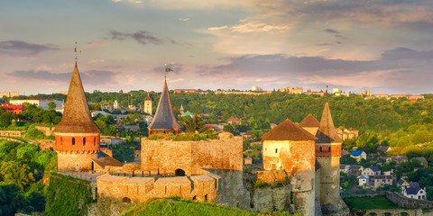 Medieval Kamianets-Podilskyi fortress at sunset, Ukraine