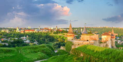 View of Kamianets-Podilskyi with old fortress at sunset, Ukraine