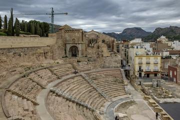 The Roman Theater, Cartagena, Spain, against stormy grey sky