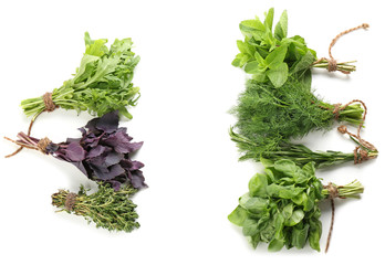 Bunches of fresh herbs on white background