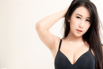 Asian young sexy lady with black long hair in black underwear