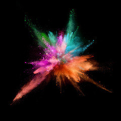 Explosion of coloured powder isolated on black background. Abstract background in high resolution.