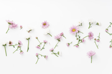 Floral pattern with tender pink and white flowers arranged as a flatlay on white background