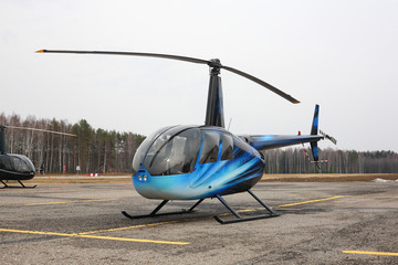 Aircraft - Turquoise small helicopter side view