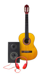 Music and sound - Classic guitar, loudspeaker enclosure and red headphone. Isolated