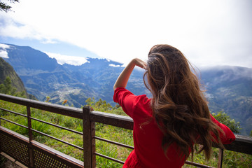 Girl watching Cilaos from La Fenetre des Makes in Saint Louis, Reunion Island