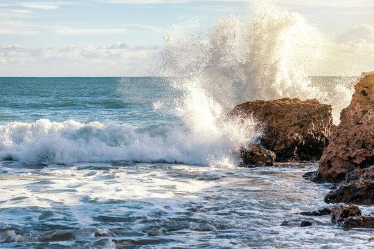 Ocean waves break against the rocks, Portugal, beautiful nature landscape
