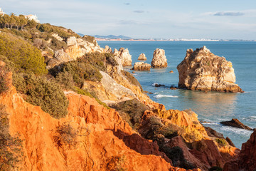 Wall Mural - Beautiful scenery, red rocks and ocean, Atlantic coast, Portugal, Algarve, Faro