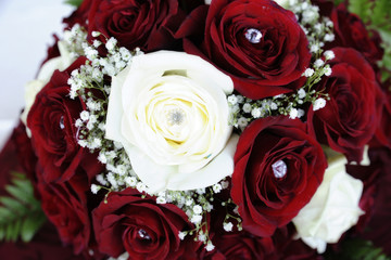 Elegant red and white roses wedding bouquet with white rose in the center
