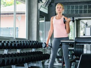 Beautiful woman exercising at gym