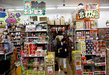 Shopper takes a look on products at Japanese discount retailer Don Quijote Holdings' store in Tokyo
