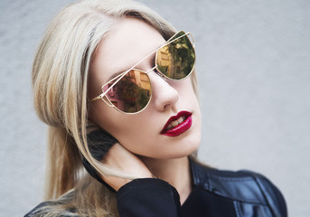 Young blonde woman wearing sunglasses