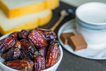 Dry dates fruit in small bowl