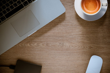 cup of coffee with laptop on wooden  table