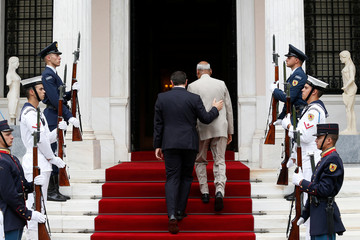 Greek Prime Minister Alexis Tsipras welcomes India's President Ram Nath Kovind at his office in the Maximos Mansion in Athens