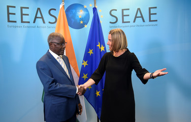 EU High Representative for Foreign Affairs Mogherini welcomes Niger's Foreign Minister Ankourao before a G5 Sahel Ministerial meeting at the EU headquarters in Brussels