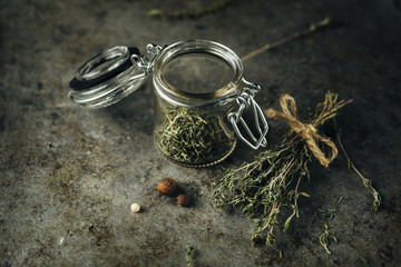 Dried thyme in a glass jar