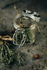 Spice jars with thyme.