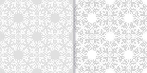 Light gray floral ornamental designs. Set of seamless patterns