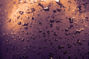 Abstract Water drop rain on black  texture and background with orang and purple filter style