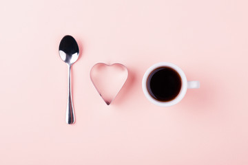 I love coffee concept with teaspoon, shape of heart and cup of coffee. Minimal design, top view.