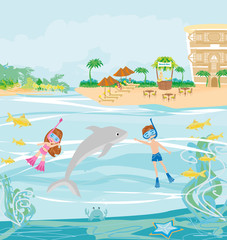 girl and boy are diving with a dolphin