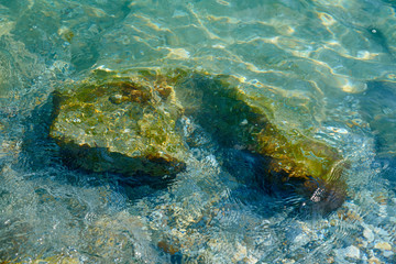 Rocks and stones under water.