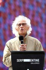 Christo speaks at the unveling of his work The London Mastaba, on the Serpentine in Hyde Park, London