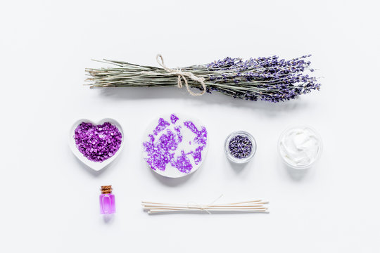 lavender flowers in organic cosmetic set on white background top