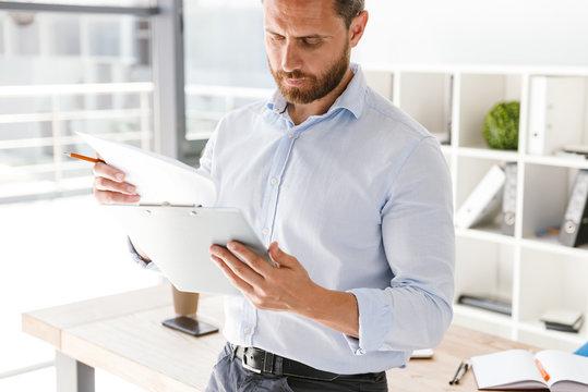 Cropped image of businessman analyzing documents